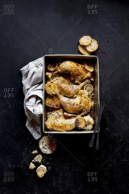 Roast Chicken Legs with sliced garlic