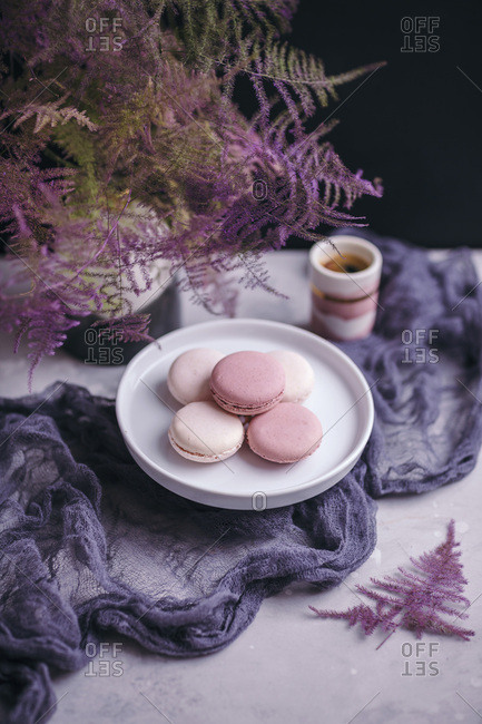 Pink macarons a white cake stand