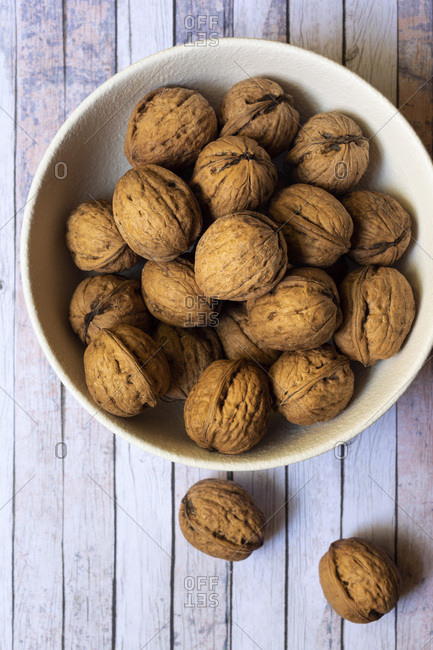 Whole walnuts in a bowl.