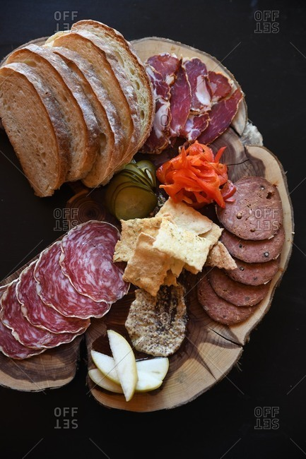 Overhead view of charcuterie board on tree trunk