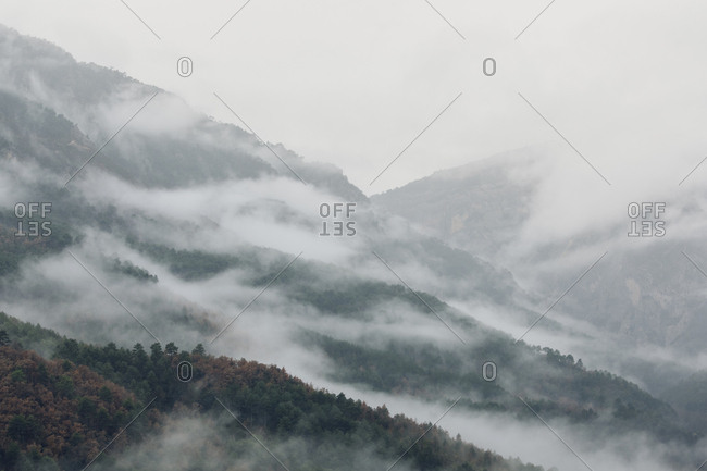 Dense mist over hills in the Pyrenees Mountains, Europe