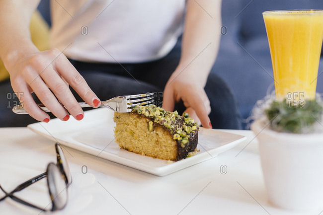 Woman heating slice of cake