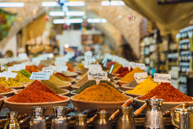Stall with assorted spices and various cezves located on market in Jerusalem, Israel