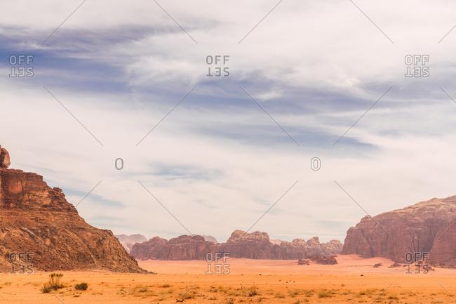 Picturesque land of desert valley with red sandstone cliffs under blue sky, Jordan