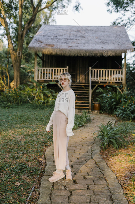 Young beautiful girl looking forward on a bungalow background