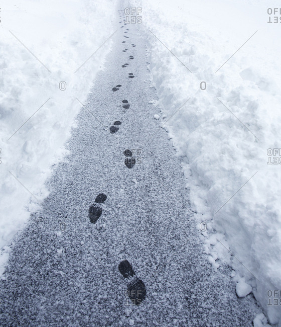 Canada, Victoria,   footsteps on snowy pathway