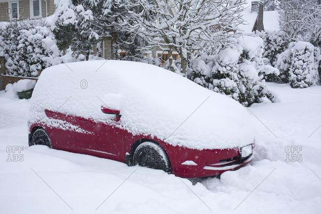 Canada Victoria, snowed in red car.