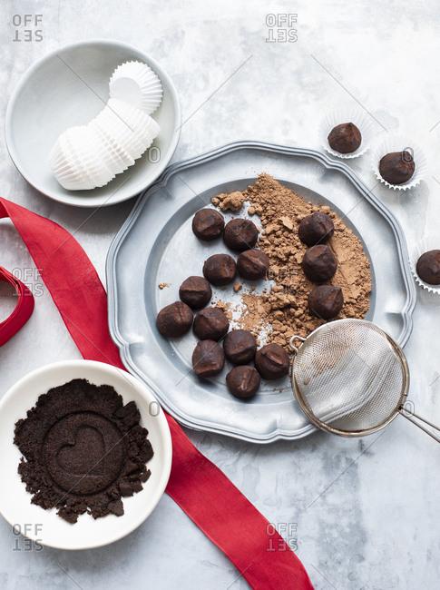 Chocolate truffles on vintage metal plate