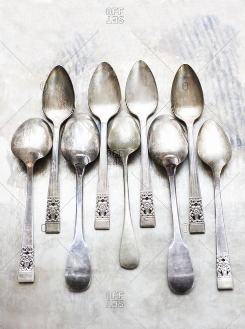Studio shot, overhead view of teaspoons in a row