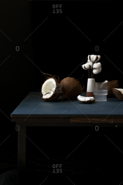 Chopped coconuts and fresh juice on a table