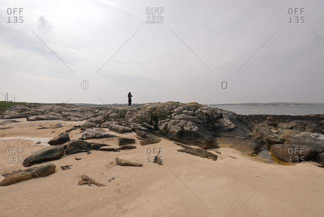 Woman looks out to the sea