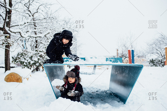 Kids playing in the snow.