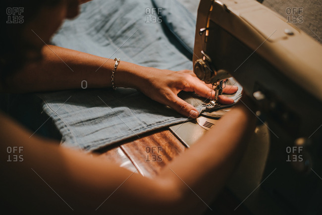 Woman sewing with a sewing machine