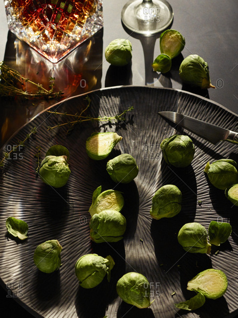 Fresh cut brussels sprouts on a silver platter