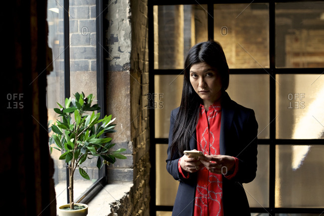 Portrait of a Asian businesswoman with a cellphone