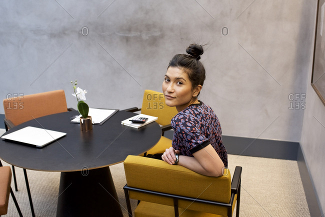 Portrait of an Asian female office worker at a desk