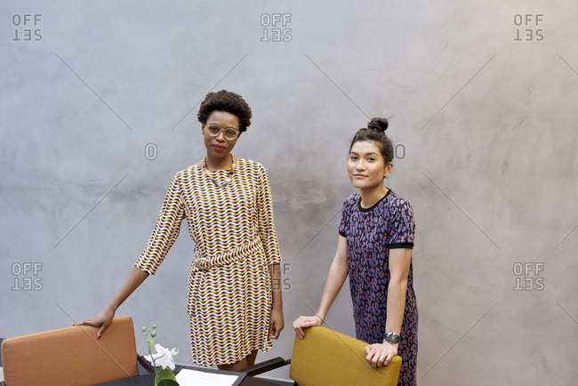 Portrait of Asian female businesswoman and black African professional colleague