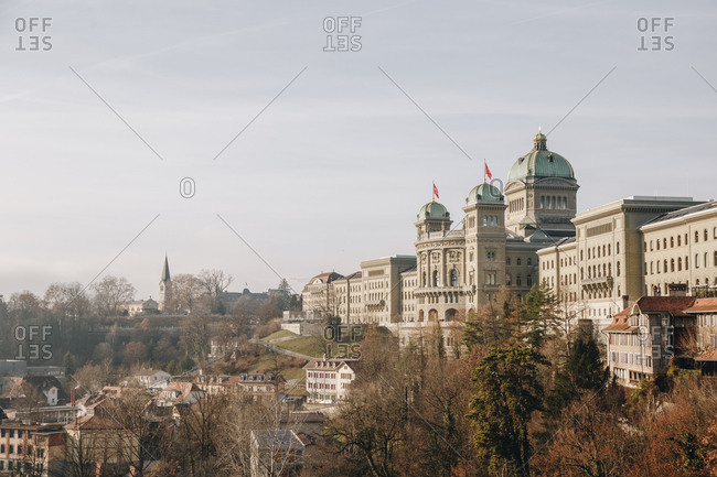 The Federal Palace building in the Swiss capital, Bern, during a sunny day in an early winter. Ideal image for tourist postcards, with enough space for text and advertising.