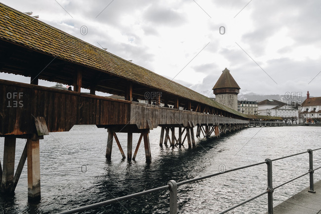 The Kapellbr�cke, an old chapel bridge, a covered wooden footbridge spanning the River Reuss diagonally in the city of Lucerne in central Switzerland