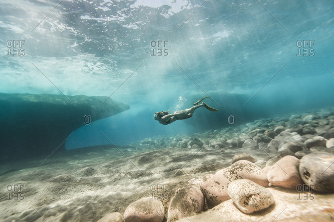 Side view of woman swimming undersea