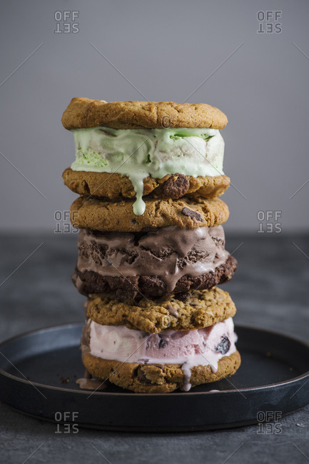 Close-up of ice cream sandwiches stacked in plate against wall on table
