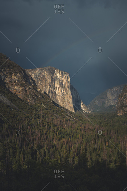 Scenic view of green landscape against cloudscape at Yosemite National Park