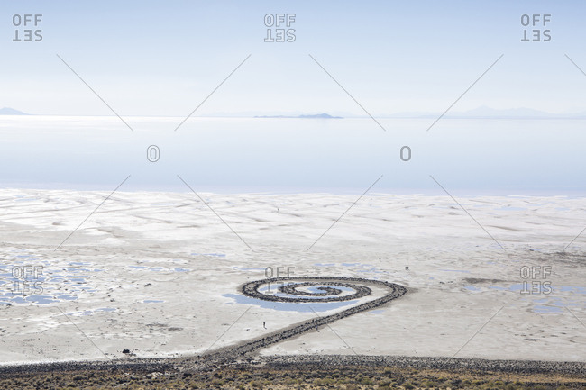 High angle view of Spiral Jetty against blue sky during sunny day