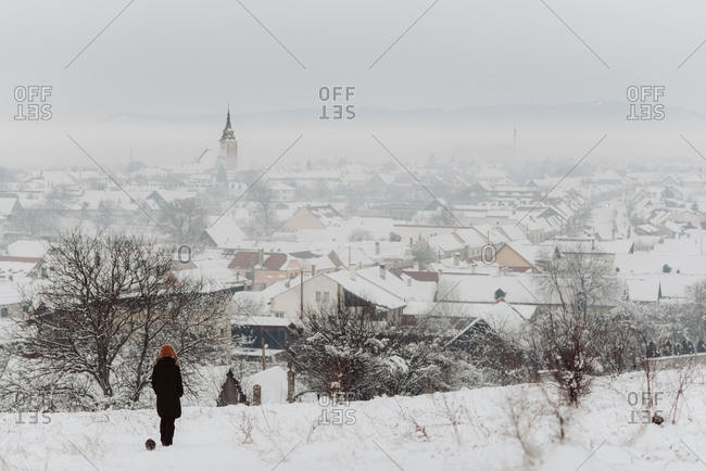 Person overlooking town on a foggy winter day