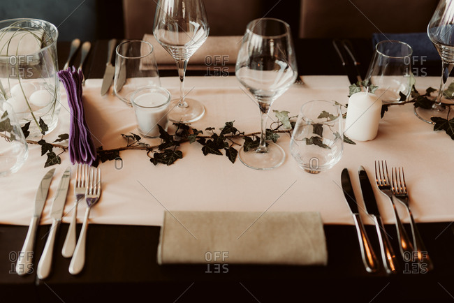Place setting at a wedding reception with vine decoration