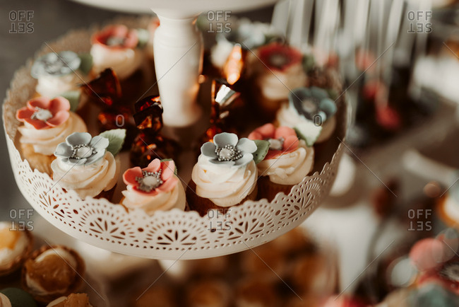 Cupcakes with flowers on a baby shower dessert table