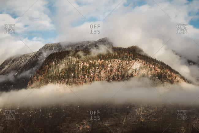 Clouds surround mountain peak