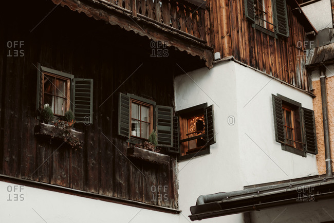 Low angle view of decor in windows of wooden building
