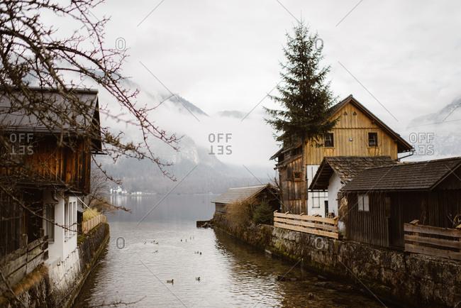 River leading into lake in a hillside village