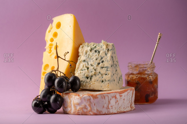 Stack of cheeses and grapes