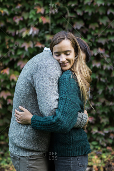 Happy affectionate couple hugging outdoors