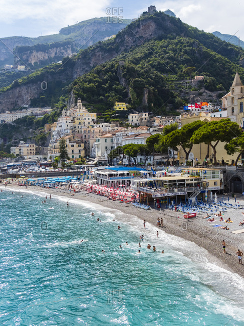 June 13, 2016: Italy- Amalfi- view to the historic old town with beach in the foreground