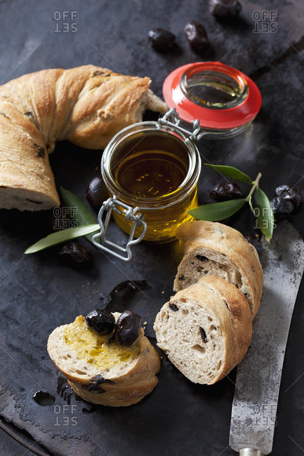 Ring bread with black olives- glass of olive oil and black olives