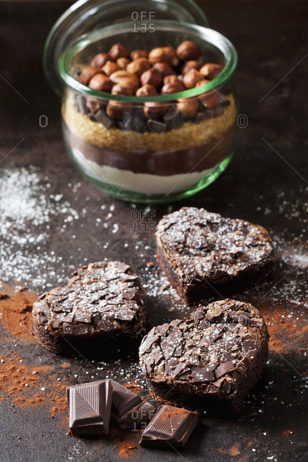 Heart-shaped brownies and glass of baking mix for preparing brownies