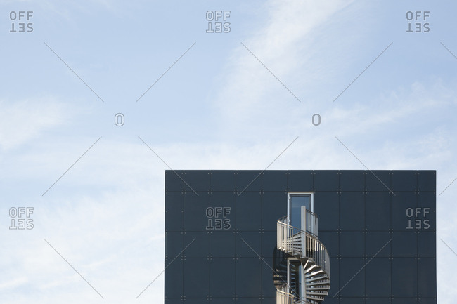 Germany- Munich- facade of modern office building with spiral staircase