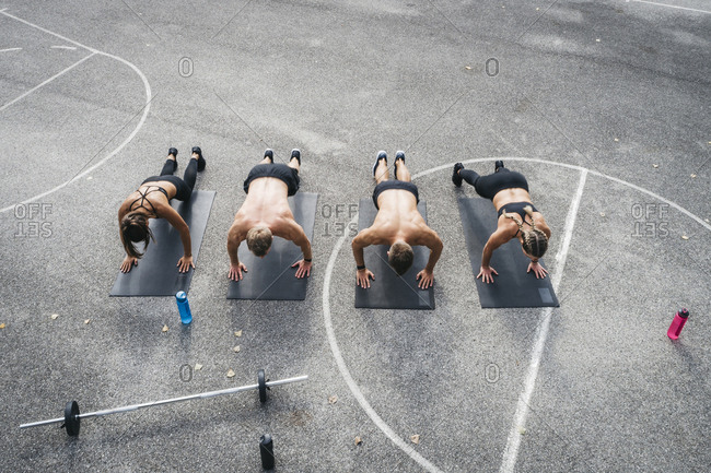 Sporty team during workout- pushups