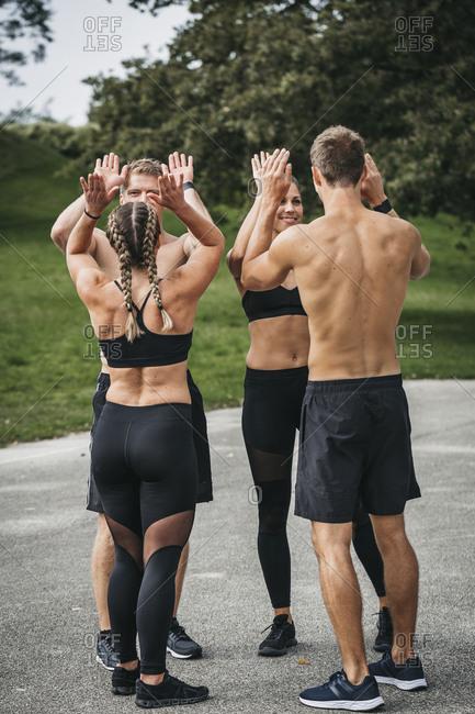 Sportive team making high five
