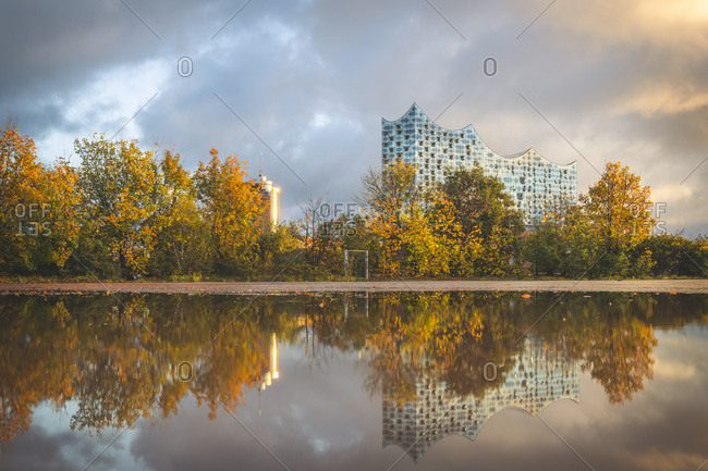 Germany- Hamburg- Elbe Philharmonic Hall- reflected in a puddle in autumn