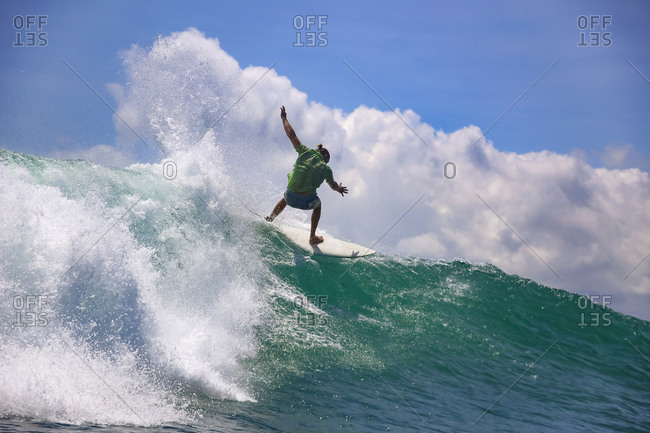 Indonesia- Bali- Kuta- surfer falling