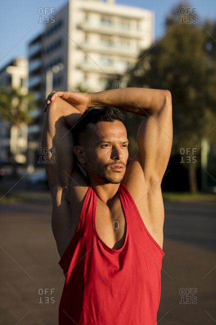 Fit man stretching before workout