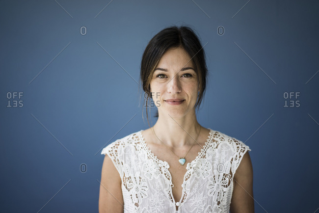 Portrait of a beautiful woman against blue background
