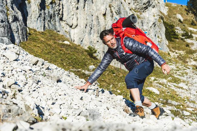 Man mountain hiking in rocky terrain