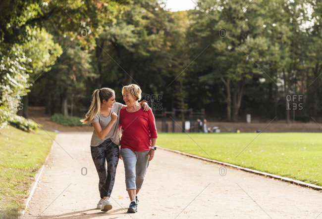 Granddaughter and grandmother having fun- jogging together in the park