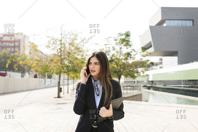 Young businesswoman talking on cell phone in the city