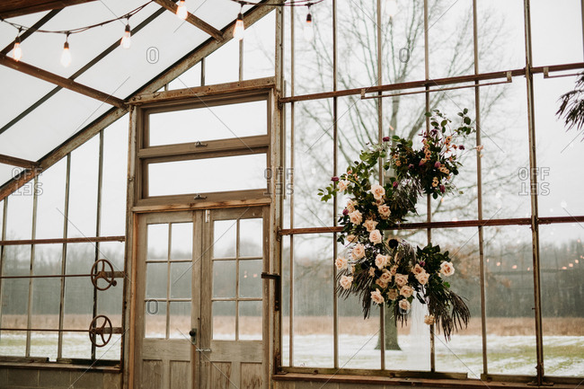 Detail of greenhouse window decorated for a wedding reception
