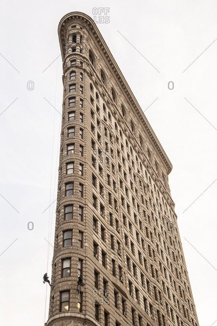 December 6, 2018: Window washer scaling the side of the famous Flatiron building in New York City, New York